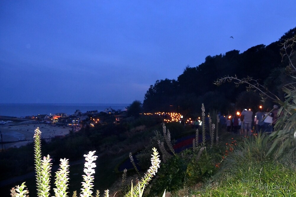 Torch Procession at Lyme Dorset.UK by lynn carter