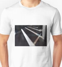 Abstract background created with lights and shadows in walkway with columns. Unisex T-Shirt