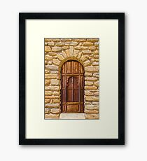 Old door and stone wall in Southern France Framed Print