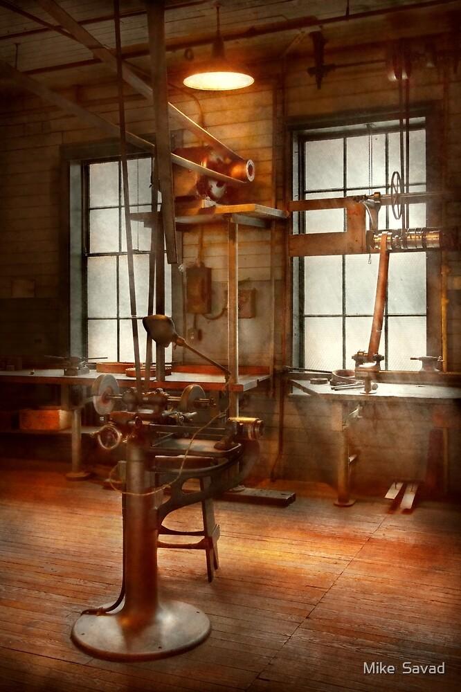 Machinist - A lone grinder  by Michael Savad