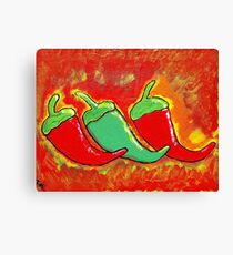 Three Spicy Chilies Canvas Print