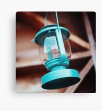 Old-fashioned blue lantern. Wooden background. Canvas Print