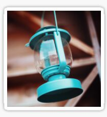 Old-fashioned blue lantern. Wooden background. Sticker