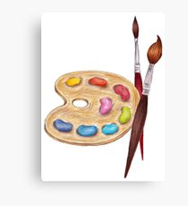 palette with paints and two brushes  Canvas Print