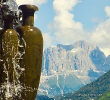 Fountain with the Dolomites beyond by L Lee McIntyre