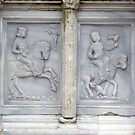 The panel depicting May on the Fontana Maggiore, Centro Storico, Perugia, Italy by Philip Mitchell