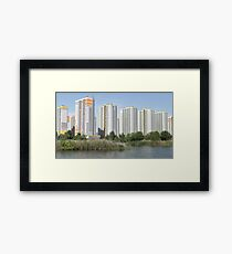modern buildings over the water Framed Print