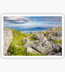 huge stones in valley on top of mountain range at sunrise Sticker
