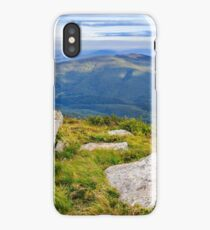huge stones in the rocky cliff iPhone Case/Skin