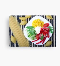 Top view of the vegetarian dish of raw vegetables and mozzarella  Canvas Print