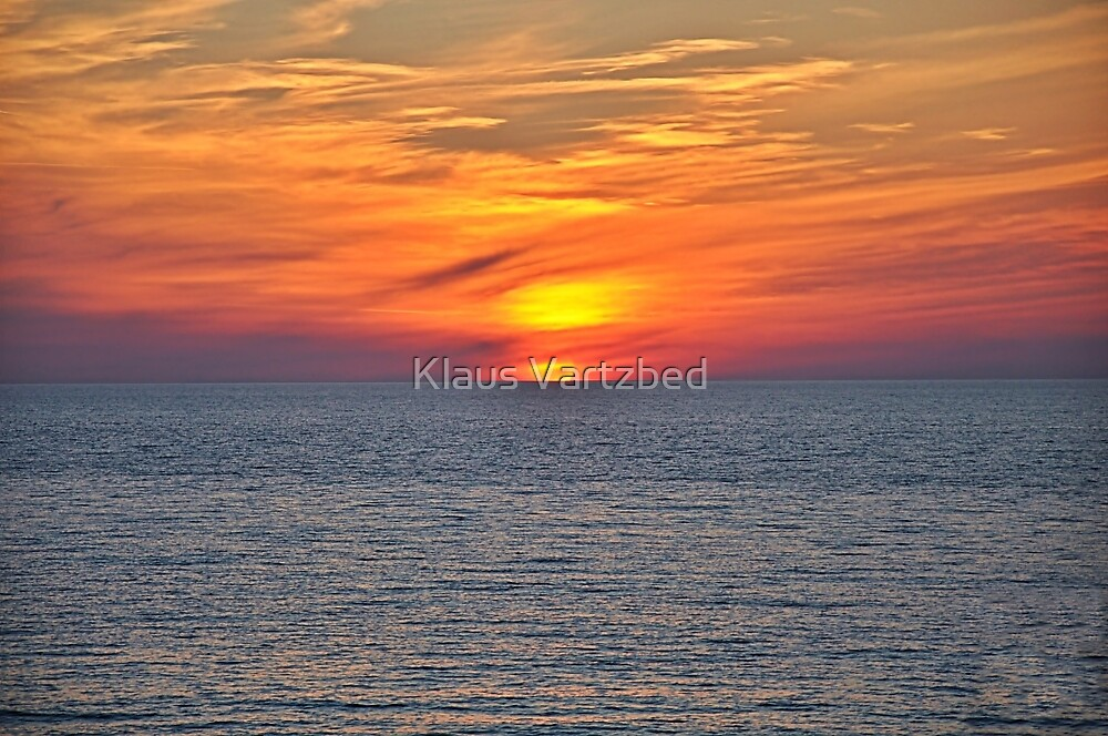 sunset over sea by Klaus Vartzbed