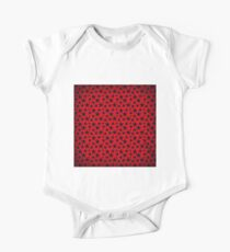 Blue stars on grunge textured bold red background Kids Clothes