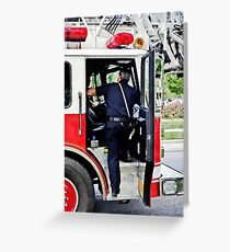 Fireman Climbing into Fire Truck Greeting Card