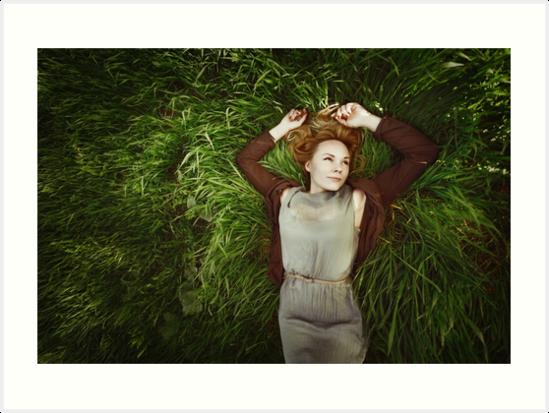 Beautiful young woman lying in the grass by dariazu