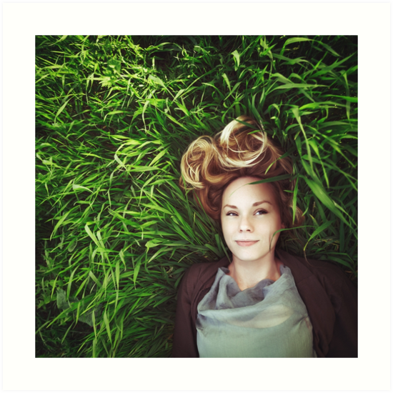 Beautiful young meditative woman in the grass by dariazu