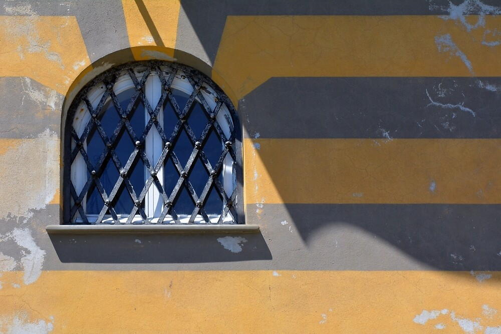 Arched window on a yellow gray striped wall by oanaunciuleanu