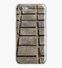 cracked paving wooden walkway iPhone Case/Skin
