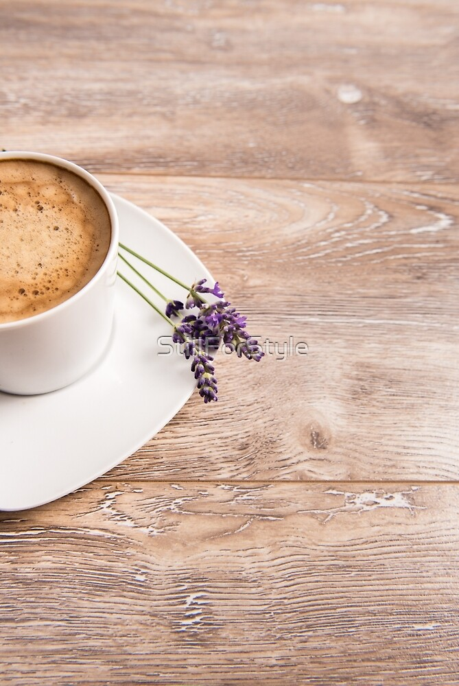 Cup of coffee on wooden background with lavenders by StillForStyle