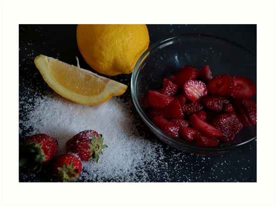 Bowl of straberries with lemon and sugar on black board. by coffeeflavour