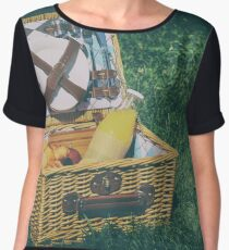 Picnic Basket With Orange Juice Bottle, Apples, Peaches, Oranges And Croissants On Green Grass In Spring Women's Chiffon Top