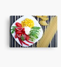 Vegetarian dish of raw vegetables and mozzarella  Canvas Print