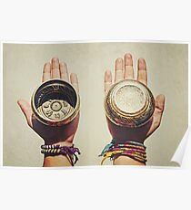 Two (2) hands holding decorated Tibetan Singing Bowls Poster