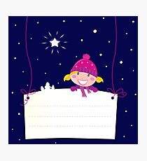 Cute christmas blond hair girl holding a blank banner label for message Photographic Print