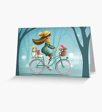 Girl riding a bike Greeting Card