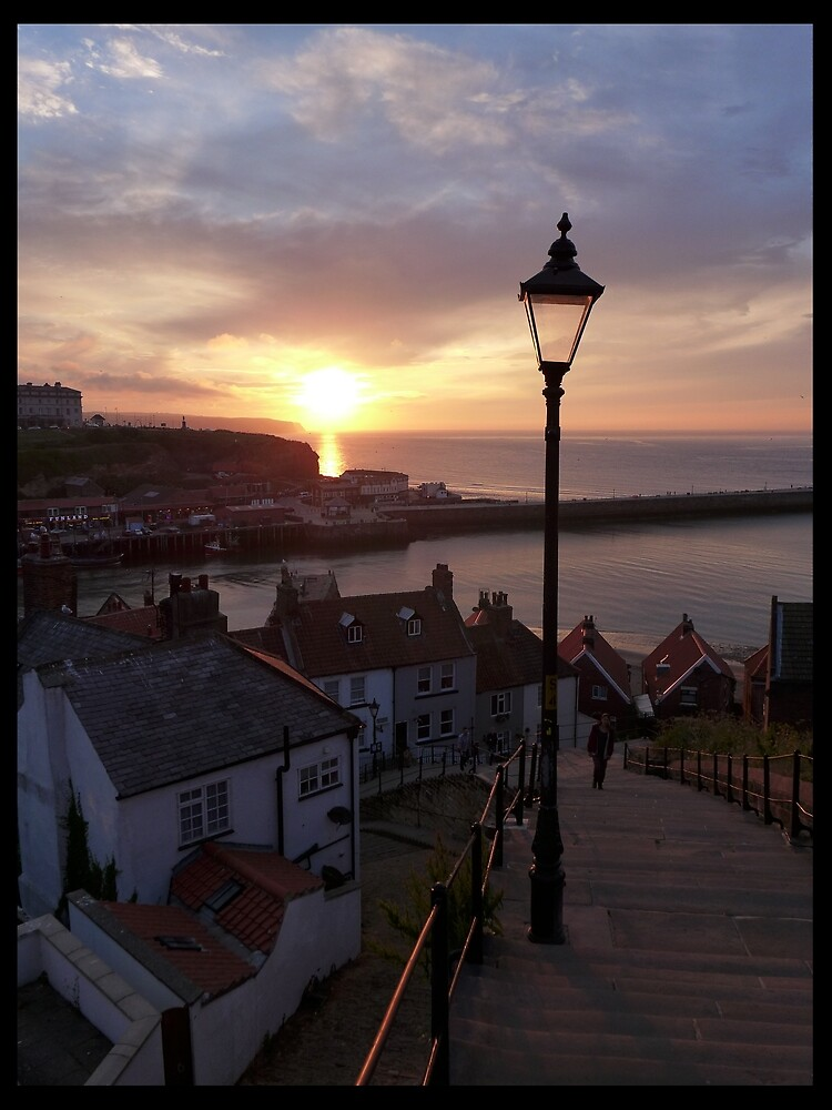 Whitby at sunset from the Abbey steps by AnnaMyerscough
