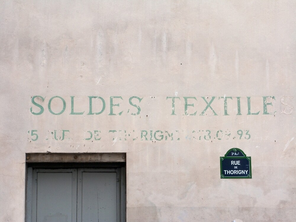 Sign on a Paris wall by Flo Smith
