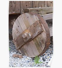 the old wooden wagon wheel Poster