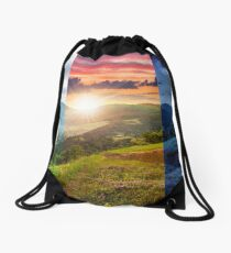 flowers on hillside meadow with forest in mountain Drawstring Bag