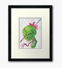 Slain Greenskull Framed Print