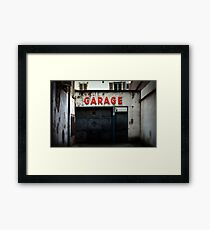 Old abandoned garage with red sign in historical center of Strasbourg Framed Print