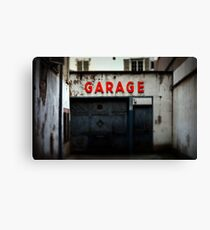 Old abandoned garage with red sign in historical center of Strasbourg Canvas Print