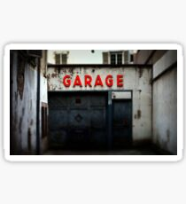 Old abandoned garage with red sign in historical center of Strasbourg Sticker
