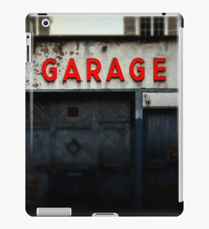 Old abandoned garage with red sign in historical center of Strasbourg iPad Case/Skin