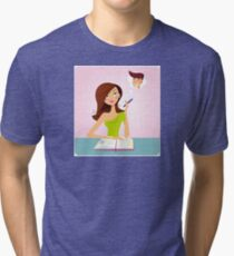Young student girl is daydreaming while studying Tri-blend T-Shirt
