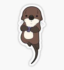 Cute otter holding a shell Sticker