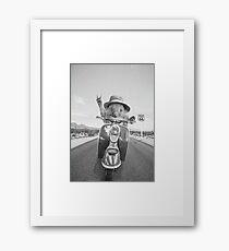 Hedgehog rides a motorbike Framed Print