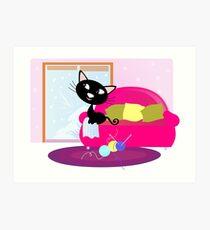 Christmas: Black Cat sitting on sofa and looking through window Art Print
