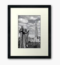 Archangel gravestone and Ancient round tower Framed Print