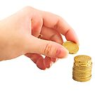 Hand placing coin in the money stack by gianliguori