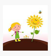 Spring gardening : Gardener child with sunflower in the garden Photographic Print