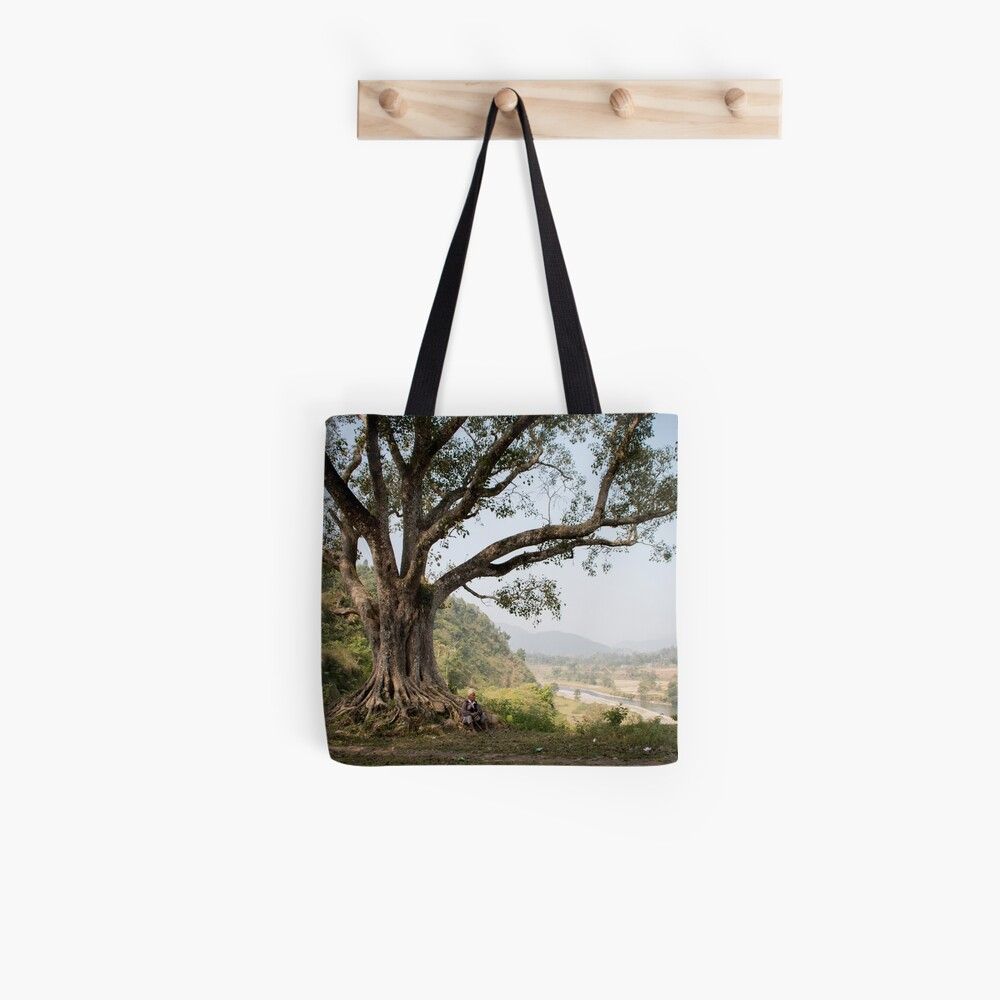 Nepali man sitting under a tree Tote Bag