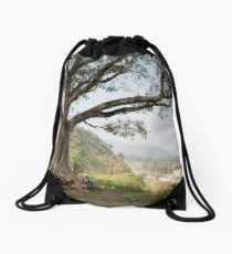 Nepali man sitting under a tree Drawstring Bag
