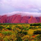 Mighty Uluru Under Fluffy White Storm Cloud by Ronald Rockman