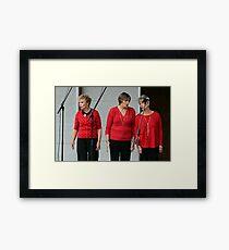 Three Ladies in Red Framed Print