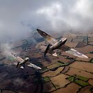 Spitfires among low clouds by Gary Eason