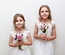 Little Girls Holding Flowers by Evita